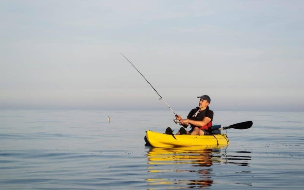 Best Ocean Fishing Kayak - Man Catching a Fish