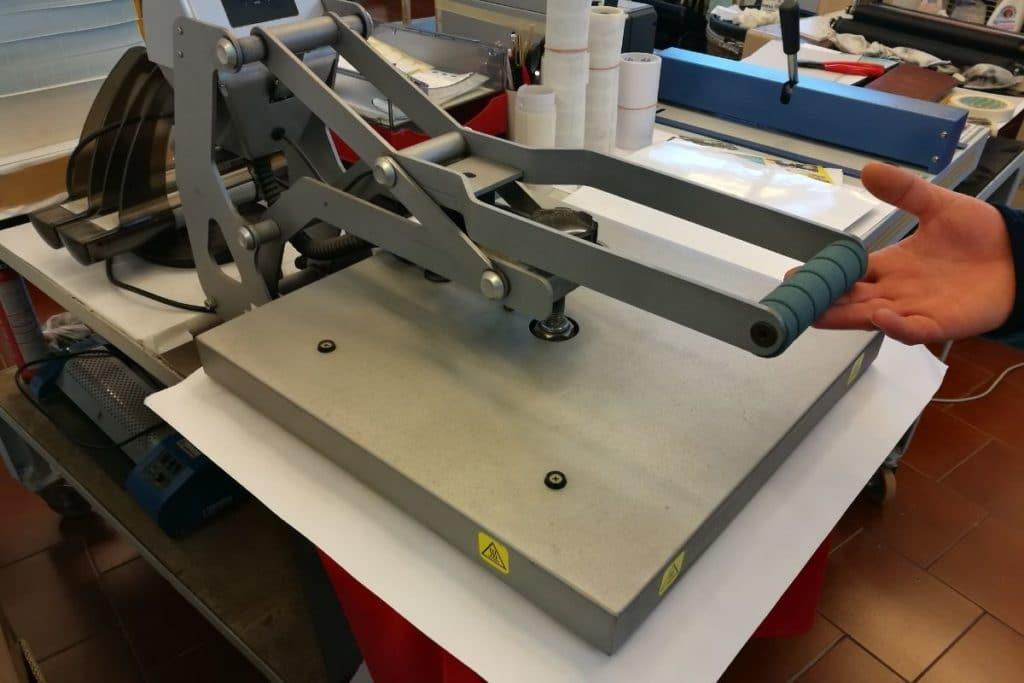Using a Heat Press Machine to detail a red t-shirt