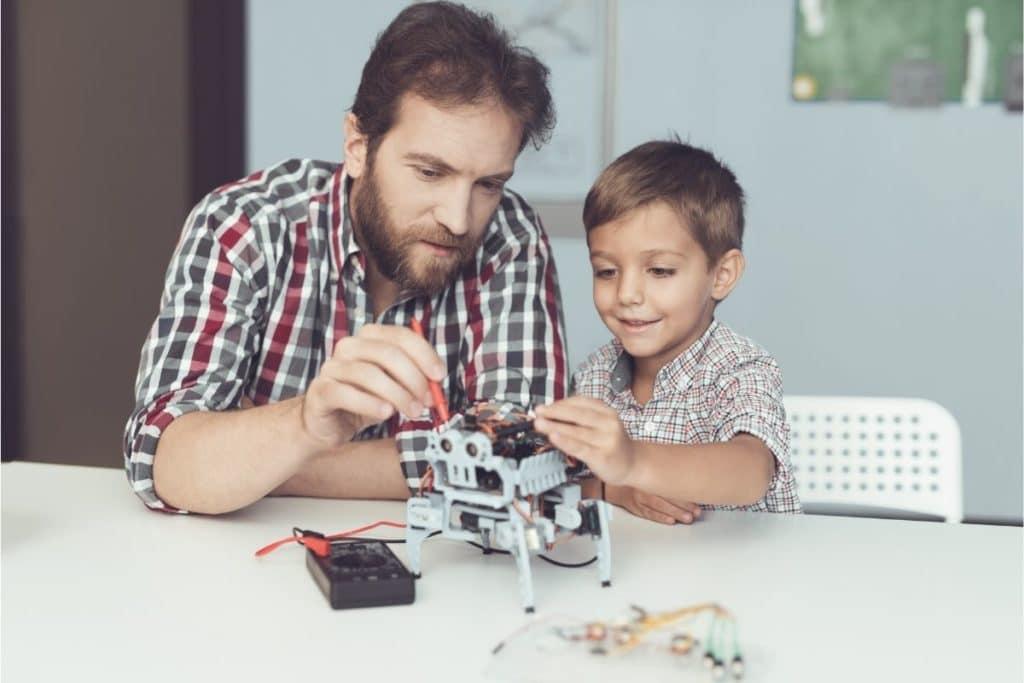 Family Using Multimeter to test robot