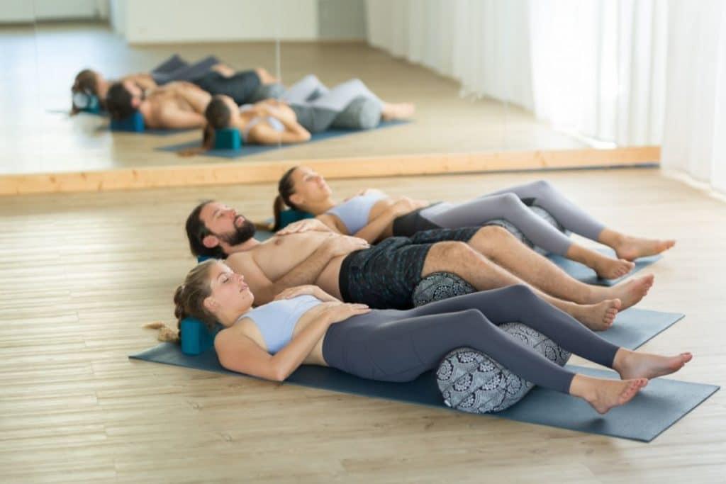 Group of three doing Restorative Yoga together