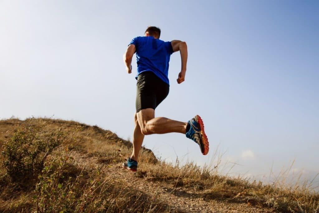 Man running up hill for cardio endurance training