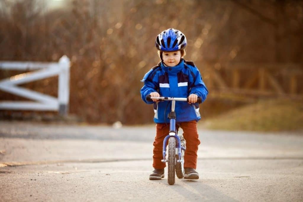 Child using one of the best balance bikes