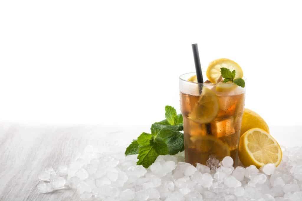 Iced tea among ice and lemons